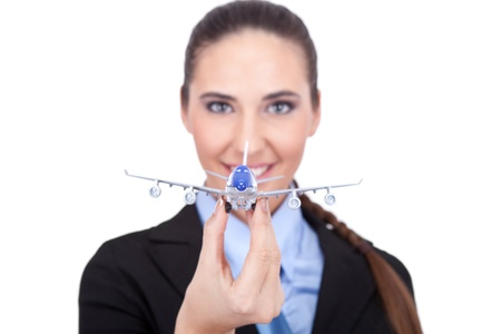 businesswoman or young  stewardess holding  plane,  plane in focus,  isolated on white background photo
