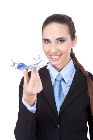 cheerful businesswoman holding  plane, young  stewardess , isolated on white background photo