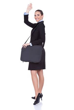 young businesswoman with suitcase going on trip, concept-business travel, isolated on white background photo