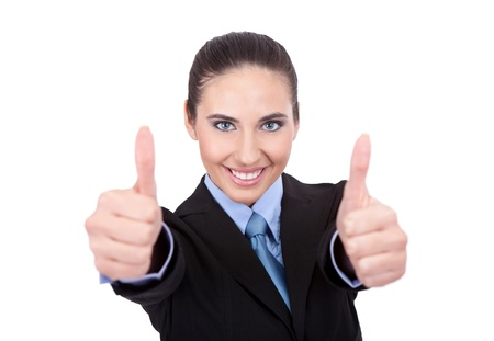 Beautiful happy blond business woman showing thumbs up isolated on white background photo
