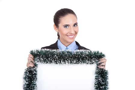 smiling businesswoman holding christmas blank billboard, isolated on white background photo
