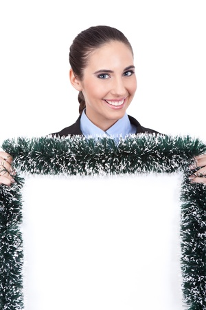 smiling businesswoman holding Christmas blank billboard, concept- Christmas advertising,  isolated on white background photo