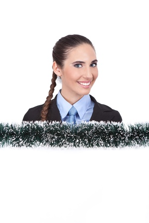smiling businesswoman   showing blank christmas sign,  isolated on white background photo