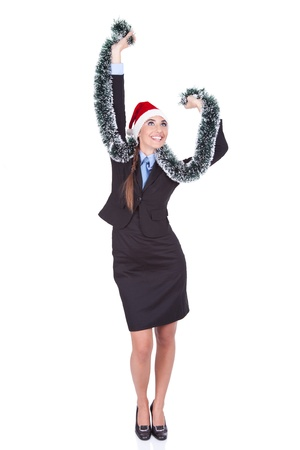 happy Santa girl celebrating and dancing in business suit photo