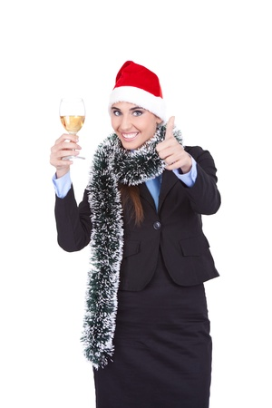 Santa businesswoman with champagnes showing thumb up photo