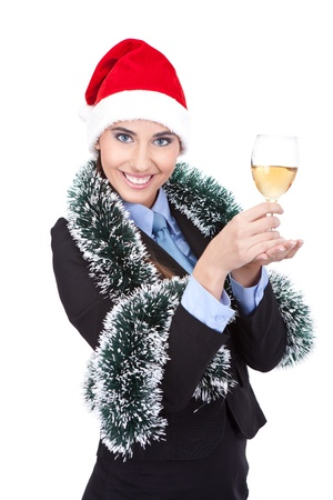 Portrait of business girl in Santa hat and with champagne, isolated on white background photo