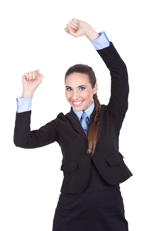 smiling business woman celebrating victory with arms raised, isolated on white background photo