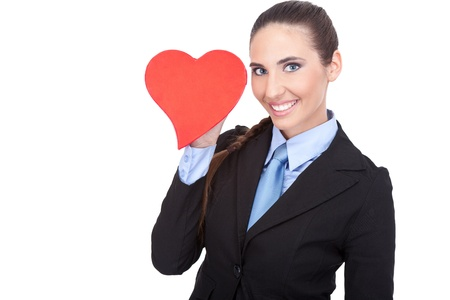 smiling  young businesswoman holding heart shape, isolated on white background Stock Photo - 11503850