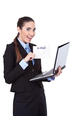 worldwideweb: smiling businesswoman holding letter  and laptop, symbolizing emailing, isolated on white background