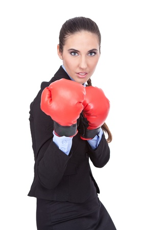 young beautiful woman with boxing gloves in guard position, isolated on white background photo