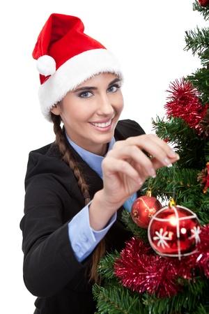 woman decorating christmas  tree, isolated on white background photo
