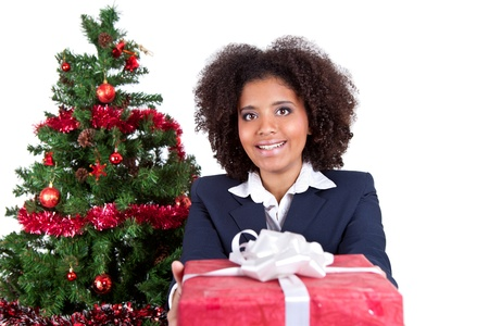 young smiling woman giving present, isolated on white background photo