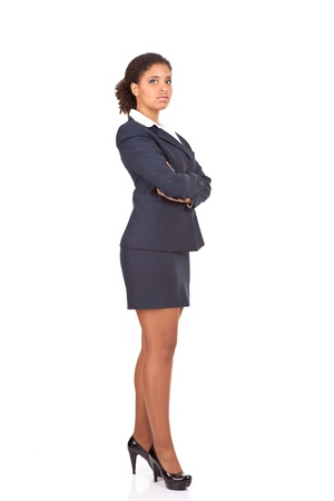 beautiful afro businesswoman posing with her arms crossed,  isolated over white background photo