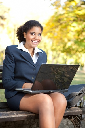 African American businesswoman  with laptop, looking in camera and smiling photo