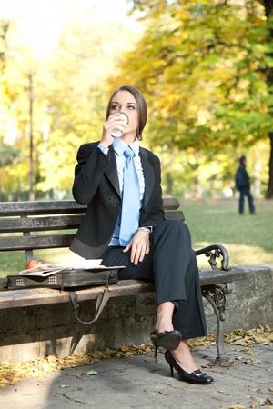businesswoman in park drinking coffee, relaxation on coffee break Stock Photo - 11506063