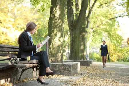 Businesspeople on break in City Park  photo