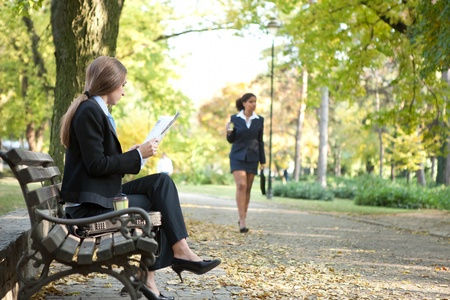 Businesspeople spending free time in park  photo