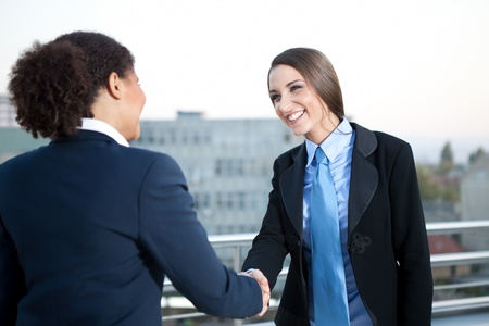 two businesswomen on meeting shaking hands photo