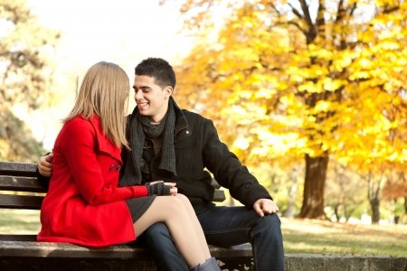 smiling young couple in love, almost kissing photo