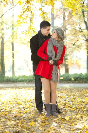 young romance couple looking each other, fashion dressed photo