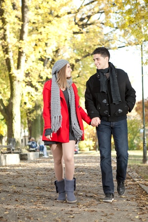 young love couple walking in romantic autumn park photo