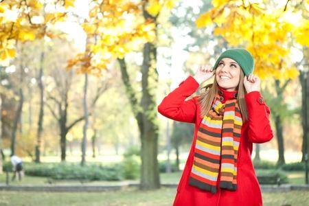 young beautiful girl  enjoying in autumn park photo