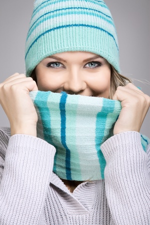 Beautiful woman with winter scarf, feeling cold photo