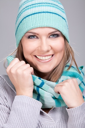 portrait of smiling winter girl with hat, close up photo