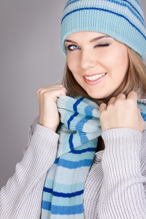 portrait of funny winter girl, winking beauty photo