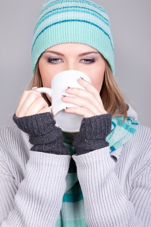 young winter girl drinking hot tea, winter time Stock Photo - 11508348