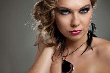 seductive woman with fashion make-up posing , close up photo