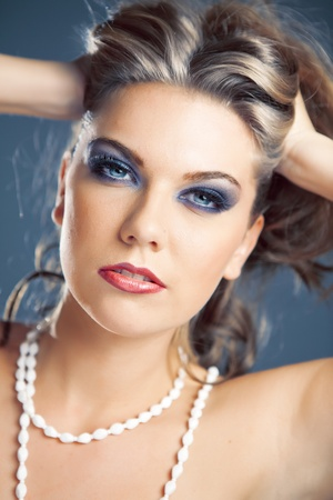 Beautiful woman,  female face with bright fashion multicolored make-up photo