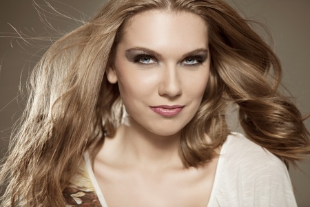 young woman with flying  hair, beautiful long blond hair photo