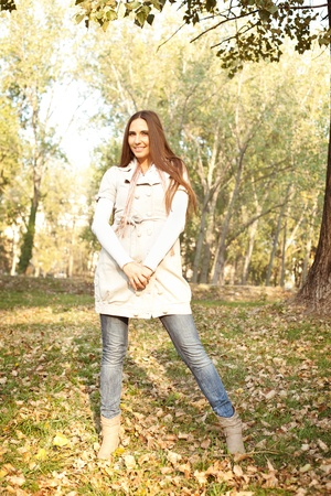 Young girl posing  in a romantic autumn park photo