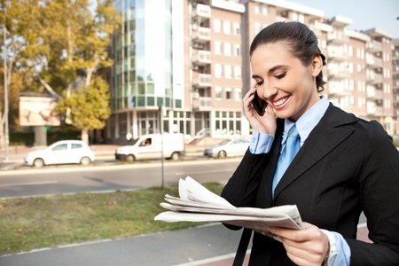 young  businesswoman well-dressed  on the phone, outdoor photo