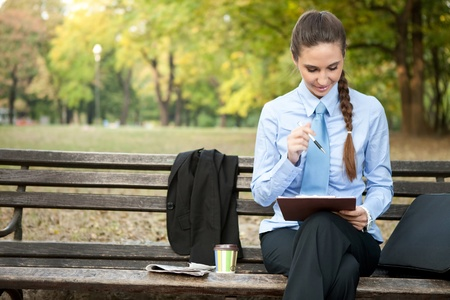 overworked businesswoman on coffee break finishing  her works Stock Photo - 11516256