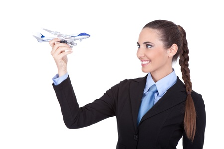 stewardess with model of plane in hand, isolated on white background photo