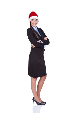 smiling businesswoman with Santa hat, confident employer,  isolated on white background photo