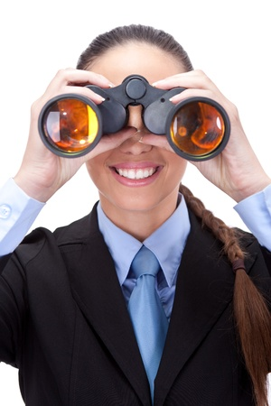 concurrence:  businesswoman looking through binoculars into the future,  isolated on white background