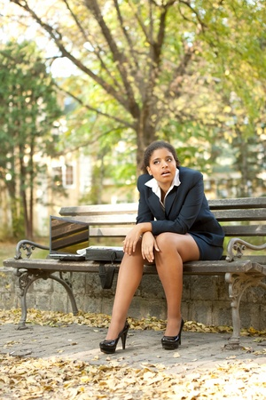 disappointed young afro businesswoman sitting in park Stock Photo - 11516290