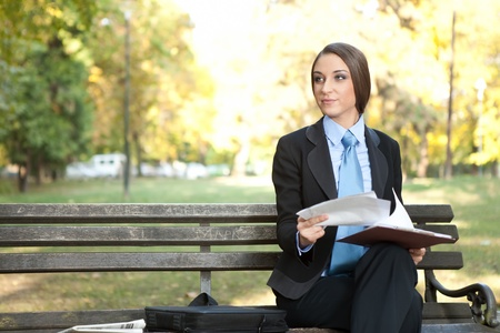 beautiful businesswoman  working with document  on break,  outdoor photo