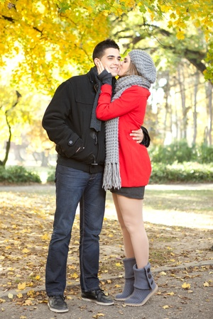 young couple kissing in autumn park, love girl kissing her boyfriend Stock Photo - 11508620