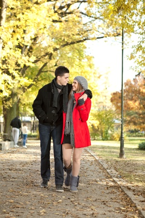 young love couple walking in autumn park,  spending time together   photo