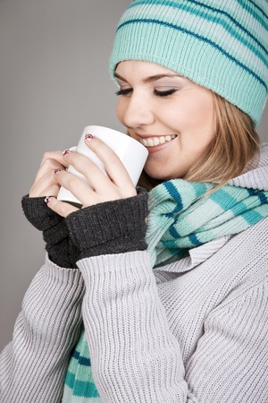 Pretty winter teenage girl holding mug with hot beverage Stock Photo - 11516333