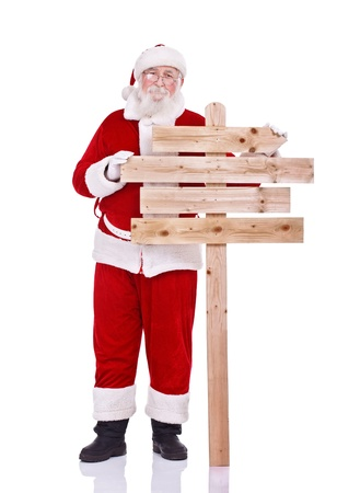 traditional Santa Claus with blank wooden sing, isolated on white background photo