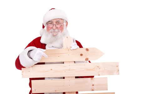 Santa Claus pointing in blank wooden sing, isolated on white background photo