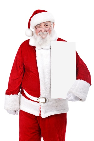Santa Claus holding white blank sign, isolated on white background photo