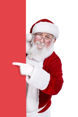 claus: Santa Claus pointing in blank red banner, isolated on white background