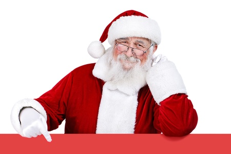 Father Christmas pointing at red banner,  isolated on white background photo