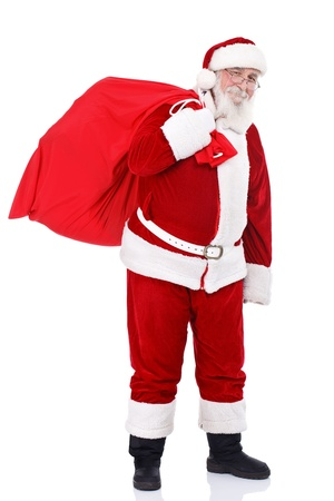 papa noel: Santa Claus bringing presents in big red bag, isolated on white background Stock Photo